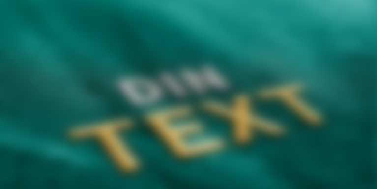 Broderad text i närbild