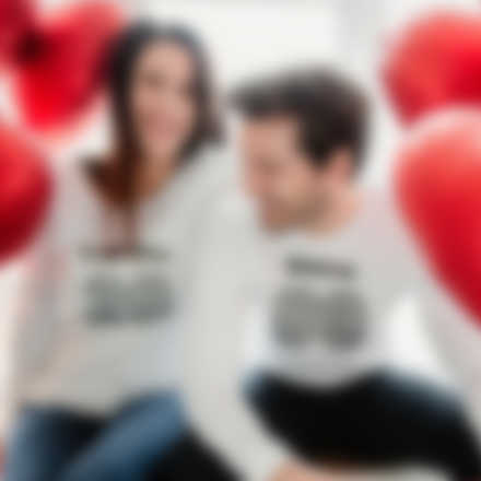 Couple wearing personalised longsleeves with Valentine\'s Day design