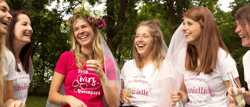 Friends enjoying a hen party in customised T-shirts