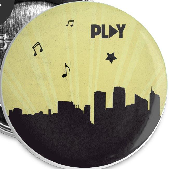 Chapa ciudad Play amarilla