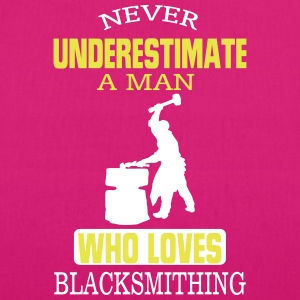 NEVER UNDERESTIMATE A MAN WHO CAN IRON FORGING! Bags & Backpacks - EarthPositive Tote Bag