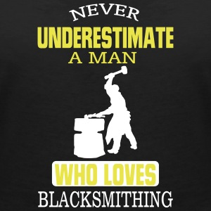 NEVER UNDERESTIMATE A MAN WHO CAN IRON FORGING! T-Shirts - Women's V-Neck T-Shirt