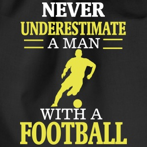 NEVER UNDERESTIMATE A MAN WITH HIS FOOTBALL! Bags & Backpacks - Drawstring Bag