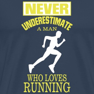 NEVER UNDERESTIMATE A MAN WHO LOVES RUNNING. T-Shirts - Men's Premium T-Shirt