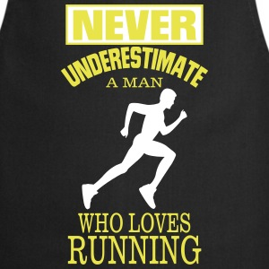NEVER UNDERESTIMATE A MAN WHO LOVES RUNNING.  Aprons - Cooking Apron