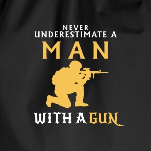 UNDERESTIMATE NEVER A MAN AND HIS GUN! Bags & Backpacks - Drawstring Bag