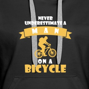 NEVER UNDERESTIMATE RIDERS A BIKE! Hoodies & Sweatshirts - Women's Premium Hoodie