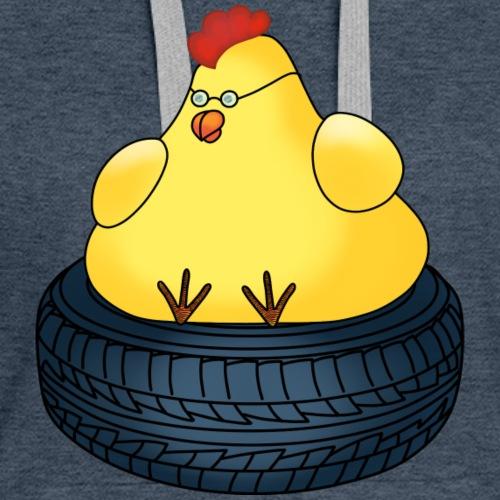 Chicken sitting on a tyre