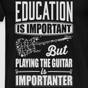 Playing the guitar is importanter than education Tops - Männer Premium T-Shirt