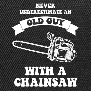 Never underestimate an old guy with a chainsaw - Snapback Cap