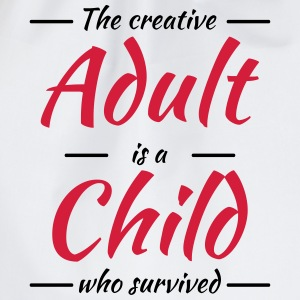 The creative adult is a child who survived T-Shirts - Drawstring Bag