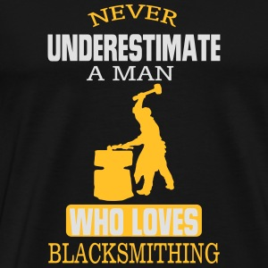 NEVER UNDERESTIMATE A MAN WHO CAN IRON FORGING! Long Sleeve Shirts - Men's Premium T-Shirt