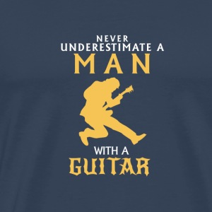 NEVER UNDERESTIMATE A MAN WITH HIS GUITAR! Sports wear - Men's Premium T-Shirt