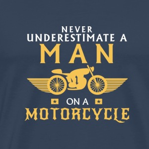 NEVER UNDERESTIMATE A MAN ON A MOTORCYCLE Sports wear - Men's Premium T-Shirt