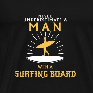 NEVER UNDERESTIMATE A MAN WITH SURFBOARD! Tops - Men's Premium T-Shirt