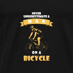 NEVER UNDERESTIMATE A MAN WITH BICYCLE! Bags & Backpacks - Men's Premium T-Shirt
