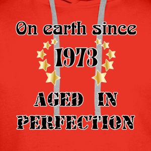 on earth since 1973 T-Shirts - Men's Premium Hoodie