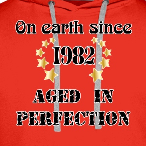 on earth since 1982 T-Shirts - Men's Premium Hoodie