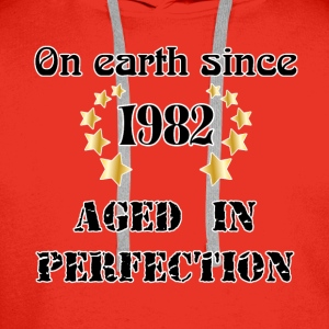 on earth since 1982 Tee shirts - Sweat-shirt à capuche Premium pour hommes