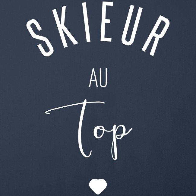 Skieur au top