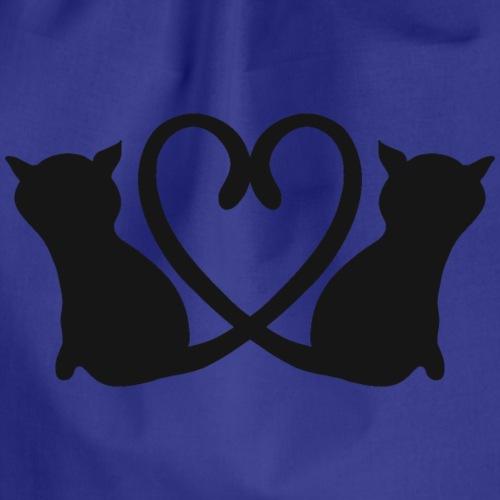 Katzen bilden ein Herz mit ihren Schwänzen