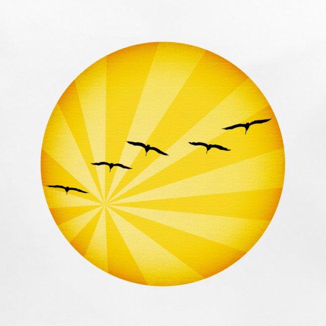 Un amanecer con pájaros en el horizonte