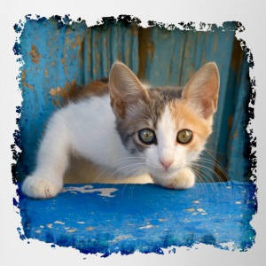 Sweet young kitten looking out of old blue door - Contrasting Mug