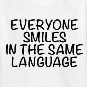 Everyone smiles in the same language - Kids' T-Shirt