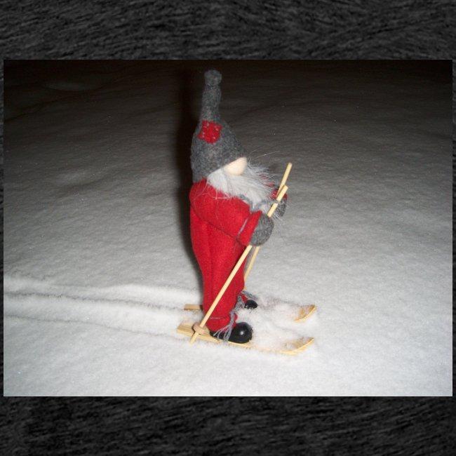 Joulutonttu hiihtämässä