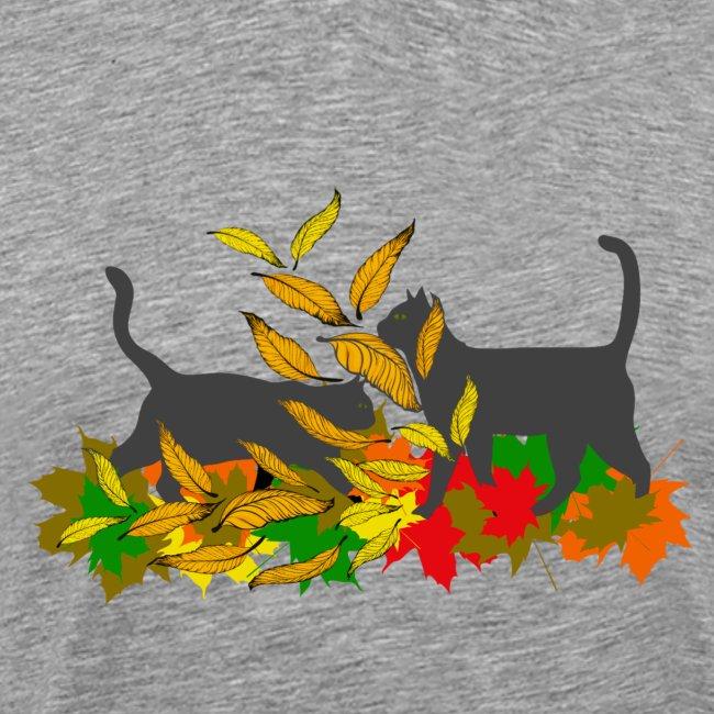 spielende Katzen in bunten Blättern