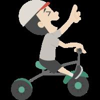 Kind, das ein Dreirad reitet