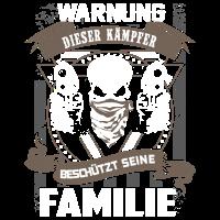 Warnung - Kämpfer schützt Familie - DE