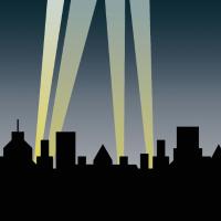 Laserstrahlen und Scheinwerfer über der Skyline