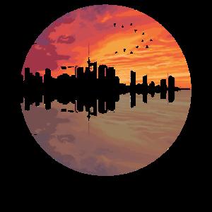 Skyline Geschenk Sonnenuntergang Spiegelung Vögel