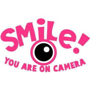 SMILE! Sie sind vor der Kamera! Fotograf