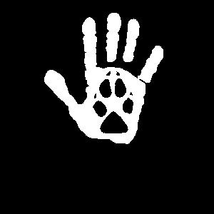 Menschliche Hand mit Hundepfote