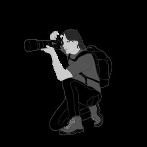 Fotograf in der Hocke
