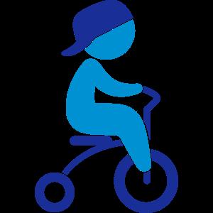 Kind fährt mit Dreirad
