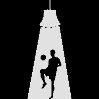 Fußballspieler im Scheinwerfer