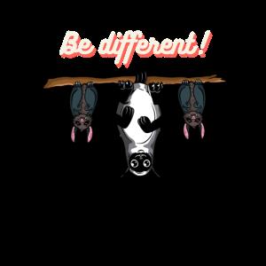 Be different! Katze und Fledermäuse am Ast