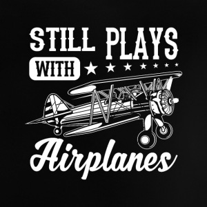 Still plays with airplanes - funny quote design T-shirts - Baby T-shirt