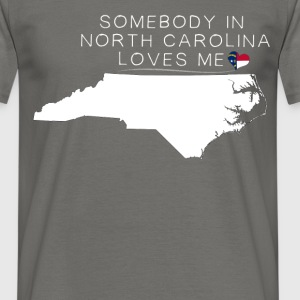 North Carolina - Somebody in North Carolina loves  - Men's T-Shirt