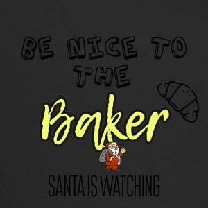 Be nice to the baker because Santa is watching - Trucker Cap