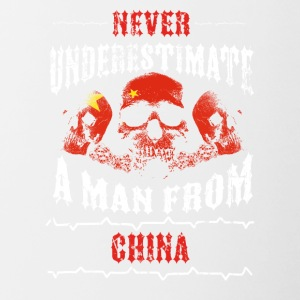 never underestimate man CHINA - Contrasting Mug