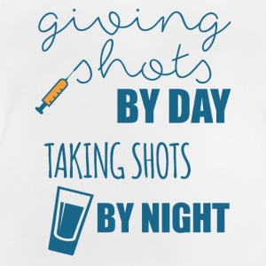 Nurse: Giving Shots By Day. Taking Shot - Baby T-Shirt