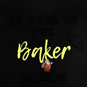 Be nice to the baker because Santa is watching - Baby T-Shirt