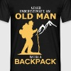Never Underestimate An Old Man With A Backpack.png - Men's T-Shirt