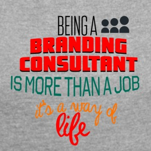 Being a branding consultant is more than a job - Frauen T-Shirt mit gerollten Ärmeln