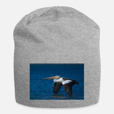 Bird A pelican flying low over the water - landscape - Beanie