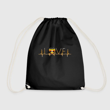 home roots home love heart from Uganda - Drawstring Bag